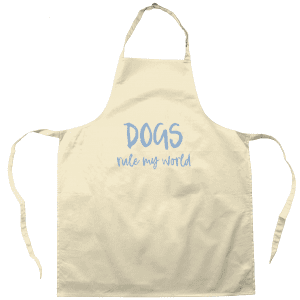 Natural colour cotton apron with Dogs Rule My World slogan on the front in pale blue