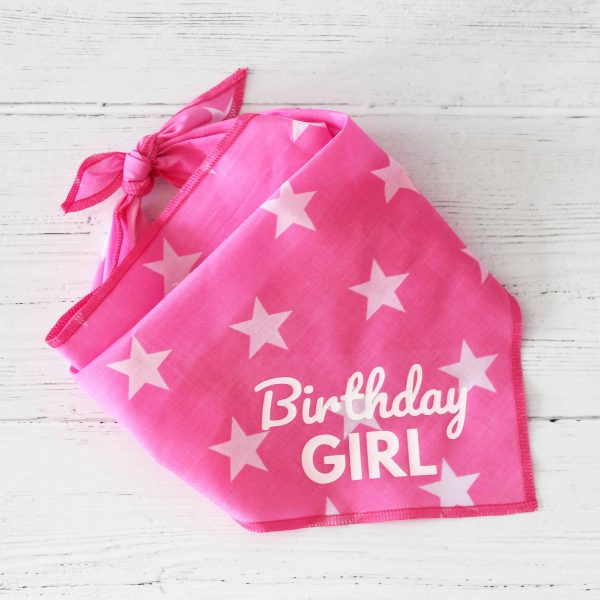 pink dog bandana with white stars and text in white that says Birthday Girl