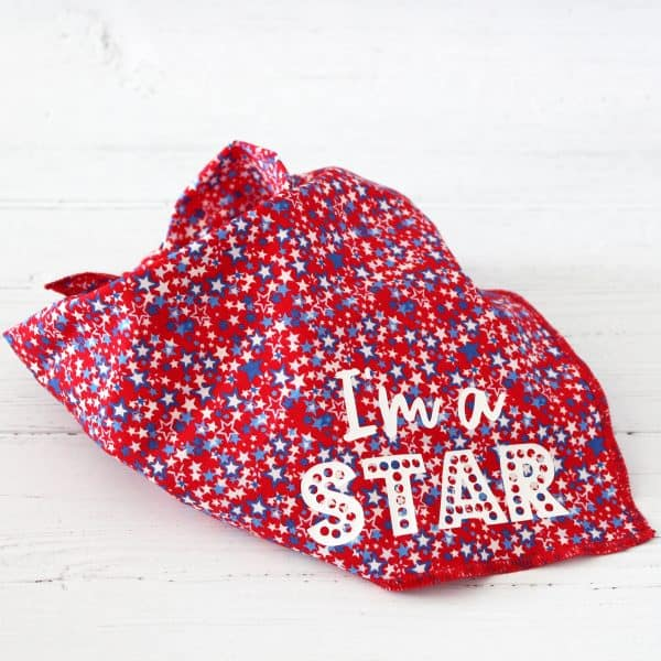 Red dog bandana, covered in small stars and words in white saying I'm A Star