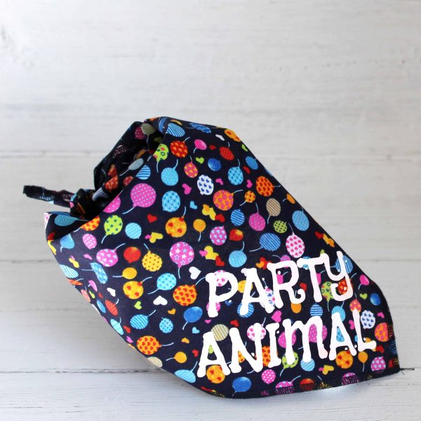 balloon and heart print tie on dog bandana with white text saying Party Animal