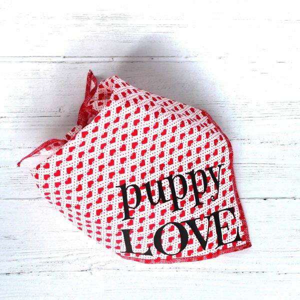 white with red hearts tie on dog bandana with text saying Puppy Love