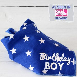 blue dog bandana with white stars and text in white that says Birthday Boy