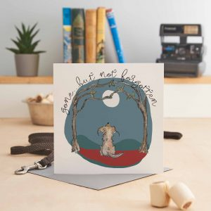 white square greeting card with a picture of a dog looking at the moon and text that says 'gone but not forgotten'