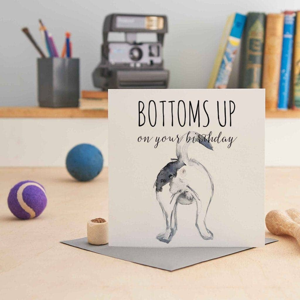white square greeting card with a picture of a terrier's bottom and text that says 'bottoms up on your birthday'