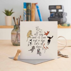 white square greeting card with 8 dog pictures and text saying all you need is love and dog lots of dogs!