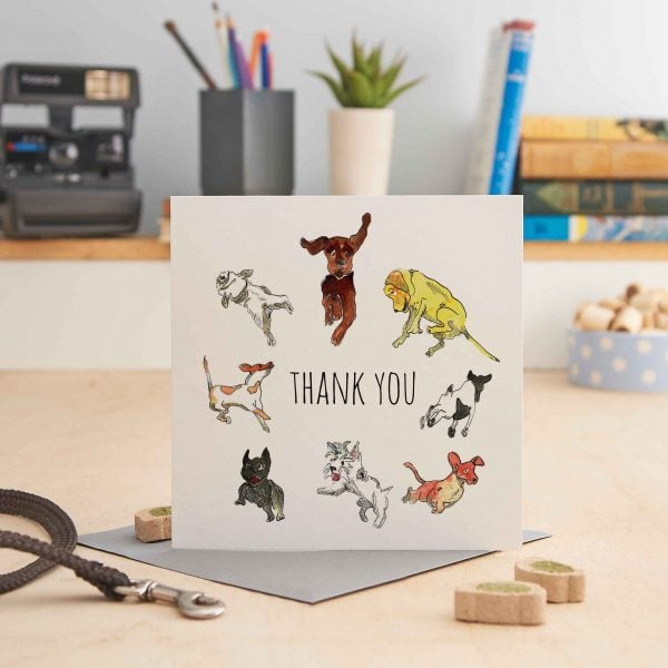 white square greeting card with 7 pictures of leaping dogs and text that says 'thank you'