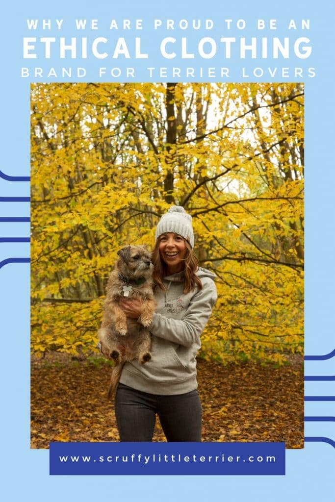 Ethical clothing for terrier lovers from www.scruffylittleterrier.com on a woman holding a border terrier in the autumnal woods
