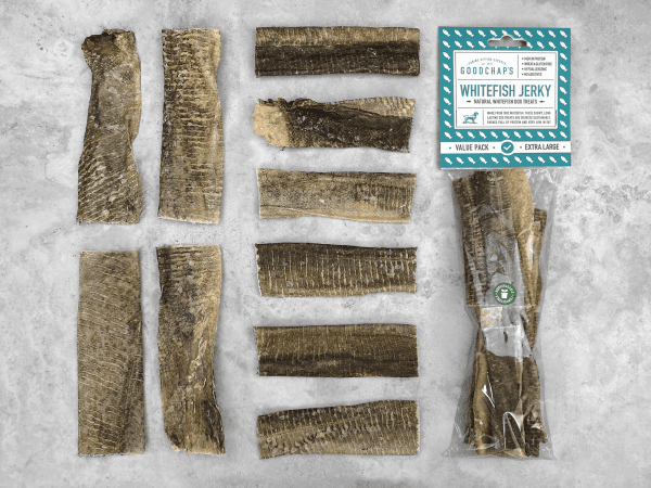 Goodchaps Whitefish Jerky Pack with a clear bag laying down with the treats laying in a row next to it.