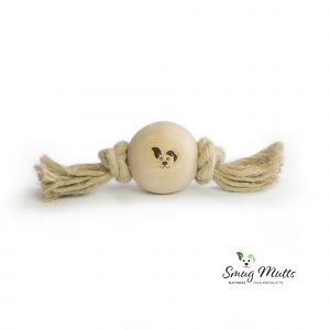 Smug Mutts wood and rope natural dog toy laying on a plain white background